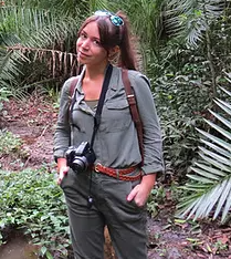a female in the jungle poses for the camera